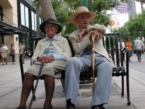senior couple taking a break during their vacation which they were able to afford because they got a Virginiatown reverse mortgage home loan